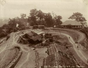 The track loop: trains climbed up to Darjeeling, then turned around and headed back down; an albumen print, c.1870; *another view of the Darjeeling track loop, c.1880's*; *another Darjeeling railway scene, c.1890's